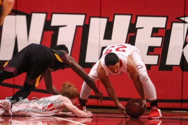 Great Bend Panther #23 Jacob Murray pulls in a loose ball as Hays Indian #14 Tyrese Hill dives for it. The Hays Indians defeated the Great Bend Panthers by a score of 51 to 37 at Great Bend High School in Great Bend, Kansas on January 10, 2017. (Photo: Joey Bahr, www.joeybahr.com)