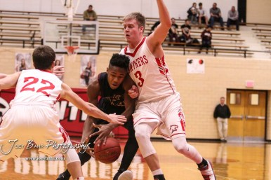 Great Bend Panther #3 Kody Crosby crashes into Hays Indian #14 Tyrese Hill. The Hays Indians defeated the Great Bend Panthers by a score of 51 to 37 at Great Bend High School in Great Bend, Kansas on January 10, 2017. (Photo: Joey Bahr, www.joeybahr.com)