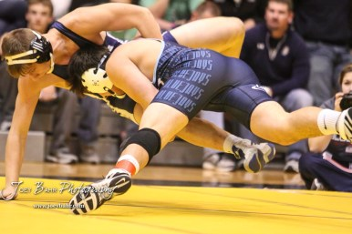 Josh Seabolt (Cimarron) takes down Cauy Rokey (Sabetha) in the weight class 182 semi-final. The KSHSAA Class 321A State Wrestling Championships were held at Gross Memorial Coliseum on the campus of Fort Hays State University in Hays, Kansas on February 24, 2017. (Photo: Joey Bahr, www.joeybahr.com)