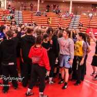 All of the girls competing in the meet gather for a breakdown. The first ever Kansas High School Girls Wrestling Championship was held at the Roundhouse at McPherson High School in McPherson, Kansas on February 11, 2017. (Photo: Joey Bahr, www.joeybahr.com)