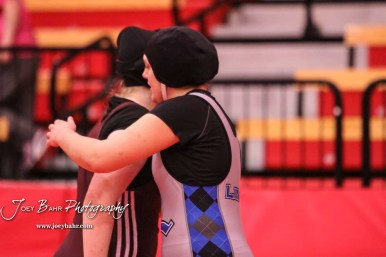 Tia Hayworth (Lincoln) embraces Dru Longbrake (Atchison-Riverbend International) after winning the match by fall. The first ever Kansas High School Girls Wrestling Championship was held at the Roundhouse at McPherson High School in McPherson, Kansas on February 11, 2017. (Photo: Joey Bahr, www.joeybahr.com)