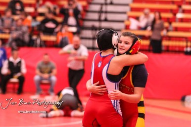 Mariyah Reyes (Dodge City) hugs Abbie Jones (Altamont-Labette County) after their match. The first ever Kansas High School Girls Wrestling Championship was held at the Roundhouse at McPherson High School in McPherson, Kansas on February 11, 2017. (Photo: Joey Bahr, www.joeybahr.com)