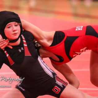 Amanda Newcomb (Osawatomie) tries to get out of a hold by Anayka Besco (Rose Hill), who won by an 11 to 3 major decision. The first ever Kansas High School Girls Wrestling Championship was held at the Roundhouse at McPherson High School in McPherson, Kansas on February 11, 2017. (Photo: Joey Bahr, www.joeybahr.com)