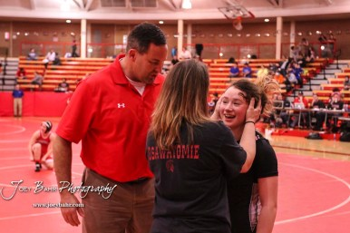 Amanda Newcomb (Osawatomie) greets her mother and her coach following her last match of the day. The first ever Kansas High School Girls Wrestling Championship was held at the Roundhouse at McPherson High School in McPherson, Kansas on February 11, 2017. (Photo: Joey Bahr, www.joeybahr.com)
