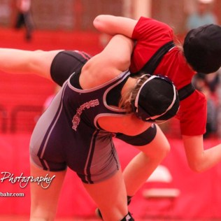 Kacie Jones (Burlingame) tosses Montana Grahem (Jefferson West) on her way to a victory by fall. The first ever Kansas High School Girls Wrestling Championship was held at the Roundhouse at McPherson High School in McPherson, Kansas on February 11, 2017. (Photo: Joey Bahr, www.joeybahr.com)