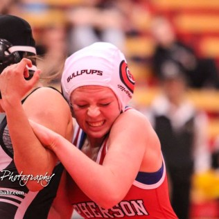 Yasmin Puentas (Wichita-Haysville Campus) tries to escape the hold of Kaleigh Marbut (McPherson). Punts would win Third in weight class 120 with a pin fall over Marbut. The first ever Kansas High School Girls Wrestling Championship was held at the Roundhouse at McPherson High School in McPherson, Kansas on February 11, 2017. (Photo: Joey Bahr, www.joeybahr.com)
