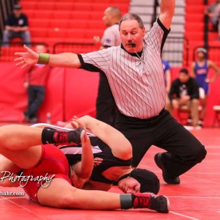 Morgan Mayginnes (Onaga) scores a near fall on Mariyah Reyes (Dodge City). Mayginnes won the match with an 8 to 3 decision. The first ever Kansas High School Girls Wrestling Championship was held at the Roundhouse at McPherson High School in McPherson, Kansas on February 11, 2017. (Photo: Joey Bahr, www.joeybahr.com)