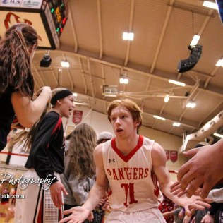Great Bend Panther #11 Konner Ireland greets fans during player introductions before the start of the game. The McPherson Bullpups defeated the Great Bend Panthers with a score of 57 to 30 at the Great Bend High School Fieldhouse in Great Bend, Kansas on February 7, 2017. (Photo: Joey Bahr, www.joeybahr.com)