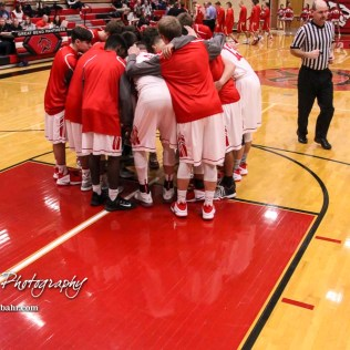 The Great Bend Panthers huddle up prior to the start of the game. The McPherson Bullpups defeated the Great Bend Panthers with a score of 57 to 30 at the Great Bend High School Fieldhouse in Great Bend, Kansas on February 7, 2017. (Photo: Joey Bahr, www.joeybahr.com)