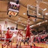 McPherson Bullpup #24 Ben Pyle goes for a layup after splitting the Great Bend Panther defense. The McPherson Bullpups defeated the Great Bend Panthers with a score of 57 to 30 at the Great Bend High School Fieldhouse in Great Bend, Kansas on February 7, 2017. (Photo: Joey Bahr, www.joeybahr.com)