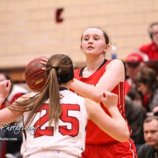 McPherson Lady Bullpup #24 Riley Hett looks for a teammate to pass the ball to. The McPherson Lady Bullpups defeated the Great Bend Lady Panthers with a score of 69 to 38 at the Great Bend High School Fieldhouse in Great Bend, Kansas on February 7, 2017. (Photo: Joey Bahr, www.joeybahr.com)