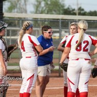 Dodge City Lady Demon Head Coach Ashley Podschun talks to her team after allowing two more runs in the Bottom of the 3rd Inning. The Great Bend Lady Panthers defeated the Dodge City Lady Demons 15 to 5 at the Great Bend Sports Complex in Great Bend, Kansas on April 18, 2017. (Photo: Joey Bahr, www.joeybahr.com)