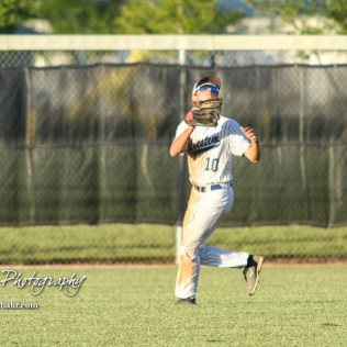 Bluestem Lion #10 Dakota Clift tracks a fly ball in the bottom of the sixth inning. The Bluestem Lions defeated the Ellis Railroaders 8 to 5 in the KSHSAA Class 2-1A State Baseball Championship game at Great Bend Sports Complex in Great Bend, Kansas on May 26, 2017. (Photo: Joey Bahr, www.joeybahr.com)