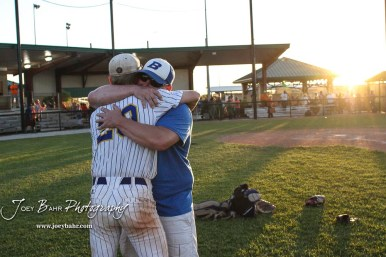 Bluestem Lion #20 Blake Bevan and his father embrace after the game. The Bluestem Lions defeated the Ellis Railroaders 8 to 5 in the KSHSAA Class 2-1A State Baseball Championship game at Great Bend Sports Complex in Great Bend, Kansas on May 26, 2017. (Photo: Joey Bahr, www.joeybahr.com)