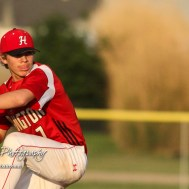 Hoisington Cardinal #7 Braxton Donovan winds up to throw a pitch in the top of the fifth inning. The Pratt Greenbacks defeated the Hoisington Cardinals 12 to 0 at Bicentennial Park in Hoisington, Kansas on May 9, 2017. (Photo: Joey Bahr, www.joeybahr.com)