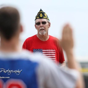 A representative of American Legion Post 180 administers the Oath of Sportsmanship. The McPherson American Legion Post 24 AAA Seniors defeated the Hutchinson American Legion Post 68 AAA Colts 6 to 4 to advance to the AAA Zone 8 Championship at the Great Bend Sports Complex in Great Bend, Kansas on July 15, 2017. (Photo: Joey Bahr, www.joeybahr.com)