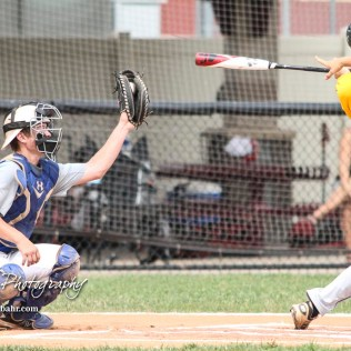 McPherson Senior Nathan (#14) catches a pitch that Hutchinson Colt Brody Smith (#1) just swung at. The McPherson American Legion Post 24 AAA Seniors defeated the Hutchinson American Legion Post 68 AAA Colts 6 to 4 to advance to the AAA Zone 8 Championship at the Great Bend Sports Complex in Great Bend, Kansas on July 15, 2017. (Photo: Joey Bahr, www.joeybahr.com)