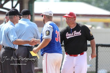 McPherson Senior Head Coach Mark Reifschneider (#36) and Great Bend Chief Head Coach Mike Perry (#26) meet with the Umpire crew at home plate prior to the start of the game. The Great Bend American Legion Post 180 AAA Chiefs defeated the McPherson American Legion Post 24 AAA Seniors 9 to 8 to win the AAA Zone 8 Championship at the Great Bend Sports Complex in Great Bend, Kansas on July 15, 2017. (Photo: Joey Bahr, www.joeybahr.com)