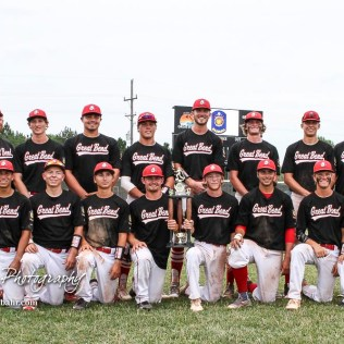 The Great Bend Chiefs line up with the Zone 8 Championship Trophy after the conclusion of the game. The Great Bend American Legion Post 180 AAA Chiefs defeated the McPherson American Legion Post 24 AAA Seniors 9 to 8 to win the AAA Zone 8 Championship at the Great Bend Sports Complex in Great Bend, Kansas on July 15, 2017. (Photo: Joey Bahr, www.joeybahr.com)