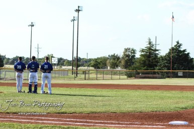 Three members of the Great Bend Batcats stand for the National Anthem. The Great Bend Batcats won the second game of the series with the Liberal Bee Jays 8 to 3 at Al Burns Memorial Field in Great Bend, Kansas on July 8, 2017. (Photo: Joey Bahr, www.joeybahr.com)