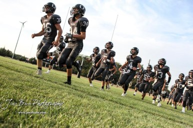 Central Plains Oilers #36 Lee Letourneau and #34 Alex Barton lead their teammates on to the field before the start of the game. The Central Plains Oilers defeated the Otis-Bison Cougars by a score of 36 to 12 at Central Plains High School in Claflin, Kansas on September 15, 2017. (Photo: Joey Bahr, www.joeybahr.com)