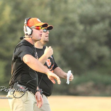Otis-Bison Cougar Head Coach Travis Starr and Assistant Coach Curtis Little signal in plays in the first quarter. The Central Plains Oilers defeated the Otis-Bison Cougars by a score of 36 to 12 at Central Plains High School in Claflin, Kansas on September 15, 2017. (Photo: Joey Bahr, www.joeybahr.com)
