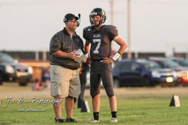 Central Plains Oiler Head Coach Chris Steiner gives #7 Devin Ryan the next play in the second quarter. The Central Plains Oilers defeated the Otis-Bison Cougars by a score of 36 to 12 at Central Plains High School in Claflin, Kansas on September 15, 2017. (Photo: Joey Bahr, www.joeybahr.com)