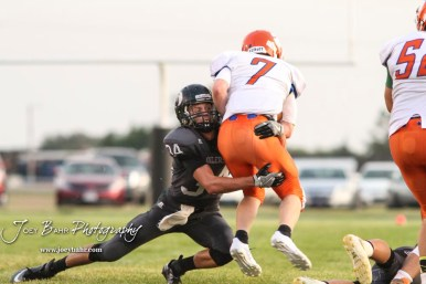 Central Plains Oiler #34 Alex Barton tackles Otis-Bison Cougar #7 Blake Bahr in the second quarter. The Central Plains Oilers defeated the Otis-Bison Cougars by a score of 36 to 12 at Central Plains High School in Claflin, Kansas on September 15, 2017. (Photo: Joey Bahr, www.joeybahr.com)