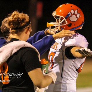 A trainer administers a concussion test to Otis-Bison Cougar #80 Seth Hoopingarner in the third quarter. The Central Plains Oilers defeated the Otis-Bison Cougars by a score of 36 to 12 at Central Plains High School in Claflin, Kansas on September 15, 2017. (Photo: Joey Bahr, www.joeybahr.com)