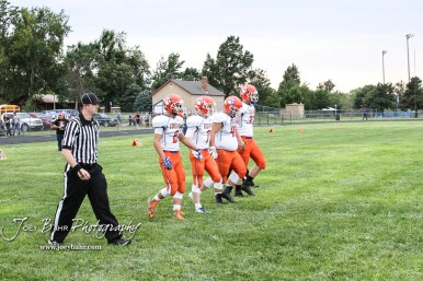 The Otis-Bison Cougar team captains walk out onto the field for the coin toss. The Otis-Bison Cougars defeated the St. John Tigers by a score of 58 to 0 at St. John High School in St. John, Kansas on September 1, 2017. (Photo: Joey Bahr, www.joeybahr.com)