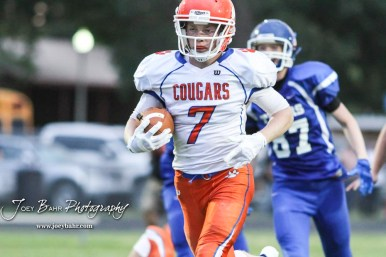 Otis-Bison Cougar #7 Blake Bahr rushes with the ball in the second quarter. The Otis-Bison Cougars defeated the St. John Tigers by a score of 58 to 0 at St. John High School in St. John, Kansas on September 1, 2017. (Photo: Joey Bahr, www.joeybahr.com)