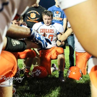 Otis-Bison Cougar #20 Bevan Gradig prays has him and his teammates hold hands following the game. The Otis-Bison Cougars defeated the St. John Tigers by a score of 58 to 0 at St. John High School in St. John, Kansas on September 1, 2017. (Photo: Joey Bahr, www.joeybahr.com)