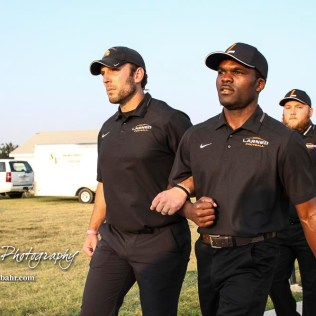 Larned Indian Head Coach A B Stokes leads his team out to the field prior to the start of the game. The Larned Indians defeated the Smoky Valley Vikings by a score of 28 to 14 at Earl Roberts Stadium in Larned, Kansas on September 8, 2017. (Photo: Joey Bahr, www.joeybahr.com)