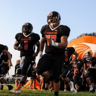 Larned Indian Christian Martinez (#70) runs out onto the field with his teammates before the start of the game. The Larned Indians defeated the Smoky Valley Vikings by a score of 28 to 14 at Earl Roberts Stadium in Larned, Kansas on September 8, 2017. (Photo: Joey Bahr, www.joeybahr.com)