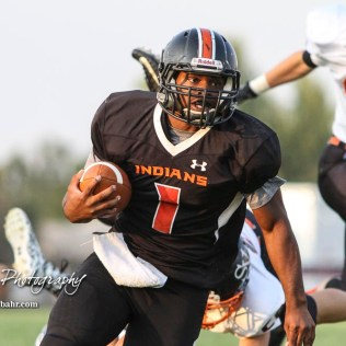 Larned Indian Anthony Mcconnell (#1) rushes with the ball in the first quarter. The Larned Indians defeated the Smoky Valley Vikings by a score of 28 to 14 at Earl Roberts Stadium in Larned, Kansas on September 8, 2017. (Photo: Joey Bahr, www.joeybahr.com)