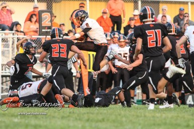 Smoky Valley Viking Tim Lambert (#8) hurdles a Larned Indian in the first quarter. The Larned Indians defeated the Smoky Valley Vikings by a score of 28 to 14 at Earl Roberts Stadium in Larned, Kansas on September 8, 2017. (Photo: Joey Bahr, www.joeybahr.com)