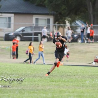 Larned Indian Logan Demond (#16) kicks the ball off after a touchdown is scored in the in the second quarter. The Larned Indians defeated the Smoky Valley Vikings by a score of 28 to 14 at Earl Roberts Stadium in Larned, Kansas on September 8, 2017. (Photo: Joey Bahr, www.joeybahr.com)
