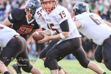 Smoky Valley Viking Brett Heitschmidt (#15) looks back to a back to give the ball to in the second quarter. The Larned Indians defeated the Smoky Valley Vikings by a score of 28 to 14 at Earl Roberts Stadium in Larned, Kansas on September 8, 2017. (Photo: Joey Bahr, www.joeybahr.com)