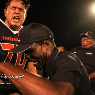 Larned Indian Head Coach A B Stokes cheers along with Christian Martinez (#70) in the post game huddle. The Larned Indians defeated the Smoky Valley Vikings by a score of 28 to 14 at Earl Roberts Stadium in Larned, Kansas on September 8, 2017. (Photo: Joey Bahr, www.joeybahr.com)