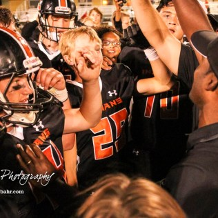 Larned Indian Head Coach A B Stokes leads his team in a post game break down. The Larned Indians defeated the Smoky Valley Vikings by a score of 28 to 14 at Earl Roberts Stadium in Larned, Kansas on September 8, 2017. (Photo: Joey Bahr, www.joeybahr.com)