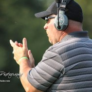 Central Plains Oiler Head Coach Chris Steiner applauds a defensive play by his team in the second quarter. The Victoria Knights defeated the Central Plains Oilers by a score of 34 to 8 at Central Plains High School in Claflin, Kansas on September 2, 2017. (Photo: Joey Bahr, www.joeybahr.com)