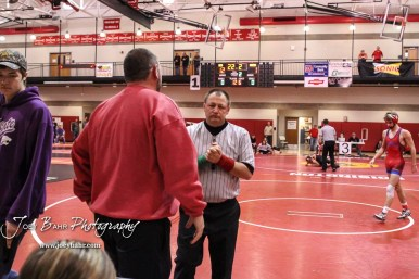 A Eureka coach discusses the score of a match with an official. The 2017 Cardinal Corner Classic Wrestling Tournament was held at Hoisington Activity Center in Hoisington, Kansas on December 15, 2017. (Photo: Joey Bahr, www.joeybahr.com)