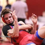 Dominick Bailey of Eureka braces as Jonny Crome of Marysville throws him in their 132 pound weight class match. Crome won the match in a 17 to 14 decision. The 2017 Cardinal Corner Classic Wrestling Tournament was held at Hoisington Activity Center in Hoisington, Kansas on December 15, 2017. (Photo: Joey Bahr, www.joeybahr.com)