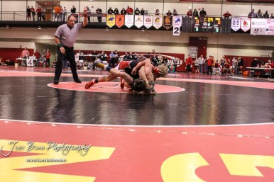 Sean Urban of Hoisington tries to roll Dylan Newton of Cimmaron on his back in the 170 pound weight class match. Urban won the match via pin fall. The 2017 Cardinal Corner Classic Wrestling Tournament was held at Hoisington Activity Center in Hoisington, Kansas on December 15, 2017. (Photo: Joey Bahr, www.joeybahr.com)