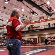 Hoisington Head Coach Dan Schmidt communicates with one of his wrestlers. The 2017 Cardinal Corner Classic Wrestling Tournament was held at Hoisington Activity Center in Hoisington, Kansas on December 15, 2017. (Photo: Joey Bahr, www.joeybahr.com)