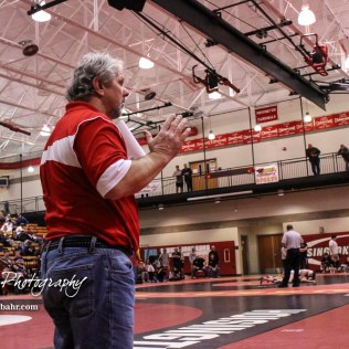 Hoisington Head Coach Dan Schmidt communicates with one of his wrestlers. The 2017 Cardinal Corner Classic Wrestling Tournament was held at Hoisington Activity Center in Hoisington, Kansas on December 15, 2017. (Photo: Joey Bahr, www.joeybahr.com)