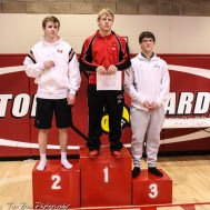 The 170 pound weight class finishers: First Place Sean Urban of Hoisington, Second Place Alan Novak of Holcomb, Third Place Garet Walker of Cimarron. The 2017 Cardinal Corner Classic Wrestling Tournament was held at Hoisington Activity Center in Hoisington, Kansas on December 15, 2017. (Photo: Joey Bahr, www.joeybahr.com)
