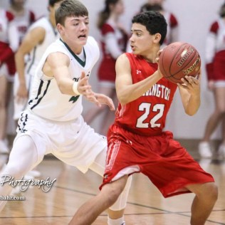 Hoisington Cardinal #22 Chase Robinson looks for a teammate to pass the ball to as Central Plains Oiler #4 Myles Menges defends. The Central Plains Oilers defeated Hoisington Cardinals by a score of 68 to 24 in a basketball game held at Central Plains High School in Claflin, Kansas on December 1, 2017. (Photo: Joey Bahr, www.joeybahr.com)