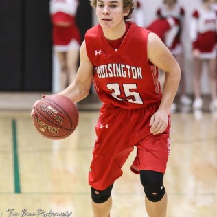 Hoisington Cardinal #25 Braxton Donovan looks for a teammate to pass the ball to. The Central Plains Oilers defeated Hoisington Cardinals by a score of 68 to 24 in a basketball game held at Central Plains High School in Claflin, Kansas on December 1, 2017. (Photo: Joey Bahr, www.joeybahr.com)
