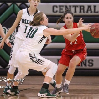 Central Plains Lady Oiler #10 Delaney Rugan steals the ball from Hoisington Lady Cardinal #22 Iris Suarez. The Central Plains Lady Oilers defeated Hoisington Lady Cardinals by a score of 88 to 23 in a basketball game held at Central Plains High School in Claflin, Kansas on December 1, 2017. (Photo: Joey Bahr, www.joeybahr.com)